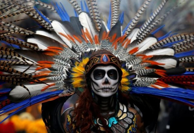 A woman dressed as a Catrina take part in a Catrina parade ahead of Day of the Dead in Mexico City