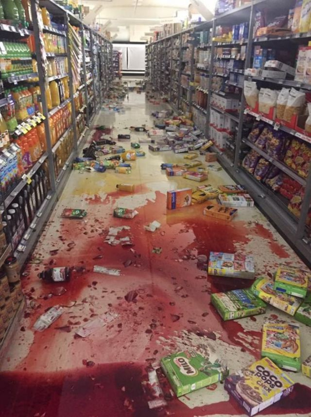 Bottles and boxes of cereals like broken on the floor of supermarket Fresh Choice Nelson City