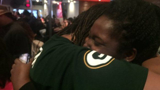 Shows Robyn and Bayana hugging and celebrating
