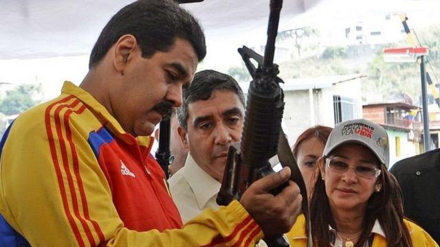 Nicolas Maduro with rifle