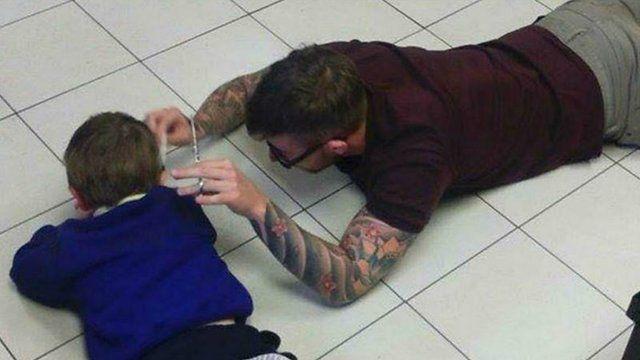James Williams cutting four-year-old Mason's hair