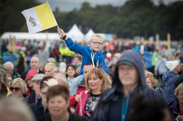 A boy waves a papal flag in Phoenix Park in Dublin
