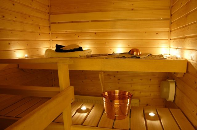 Interior of a Finnish sauna in candle light.
