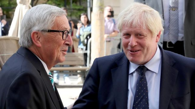 UK Prime Minister Boris Johnson shakes hands with European Commission President Jean-Claude Juncker
