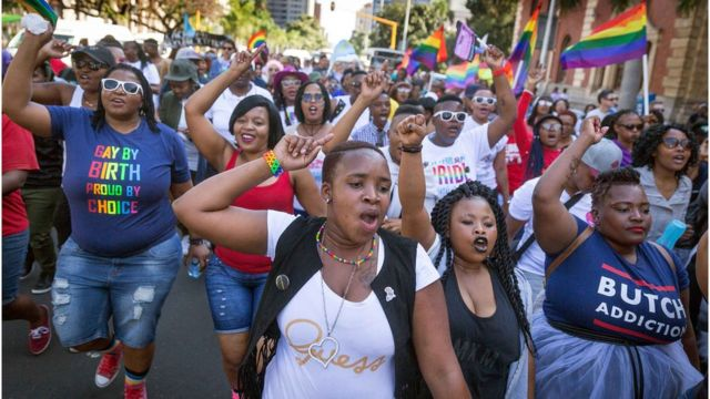 Members of the South African Lesbian, Gay, Bisexual and Transgender and Intersex (LGBTI) community chant slogans as they take part in the annual Gay Pride Parade, as part of the three-day Durban Pride Festival, on June 24, 2017 in Durban.