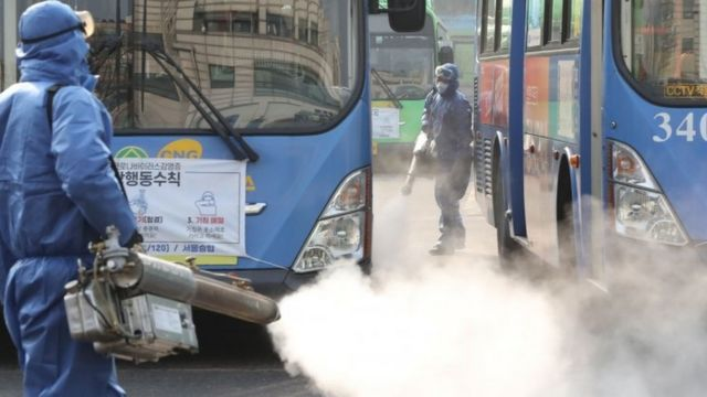 Workers spray disinfectant at a bus terminal in Seoul, South Korea. Photo: 20 February 2020