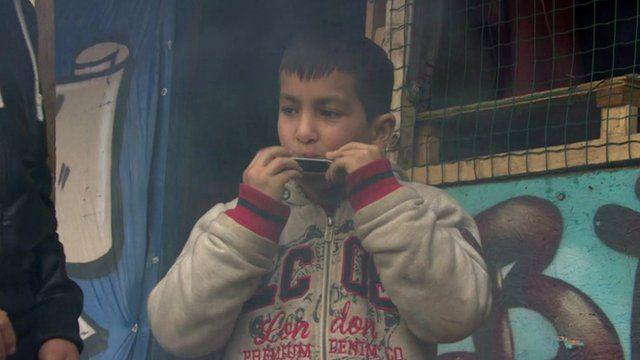 Boy playing harmonica