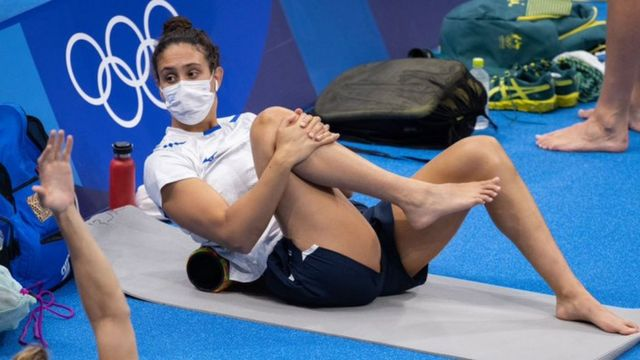 Andrea Murez stretching out before a swim in Tokyo