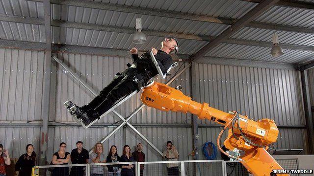 Professor Stelios Arcadiou using the robotic arm