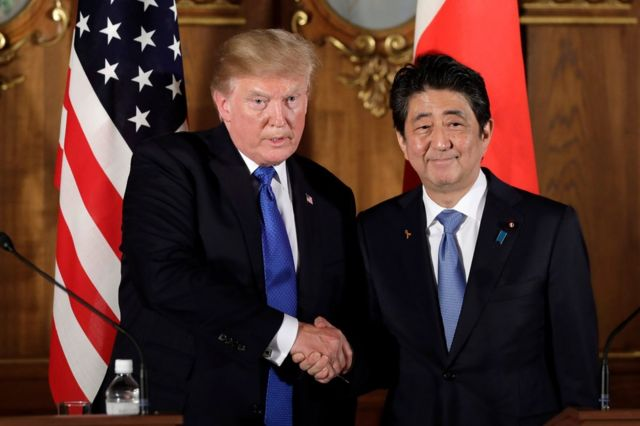 US President Donald J. Trump (L) shakes hands with Japan's prime minister Shinzo Abe (R) during a news conference at Akasaka Palace in Tokyo, Japan, 6 November 2017