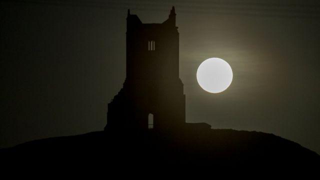 Moon next to a church
