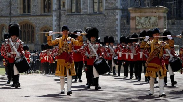 Members of a military band march into position at Windsor Castle in Windsor, west of London, on April 17, 2021, prior to the funeral service of Britain's Prince Philip, Duke of Edinburgh