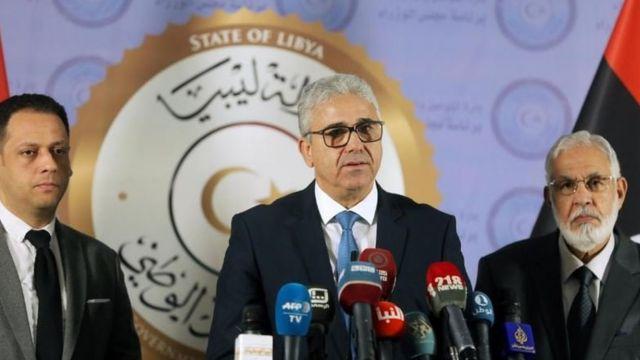 Libya Ulusal Mutabakat Hükümeti İçişleri Bakanı Fethi Başağa (ortada)