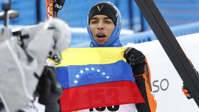 Solano con la bandera venezolana
