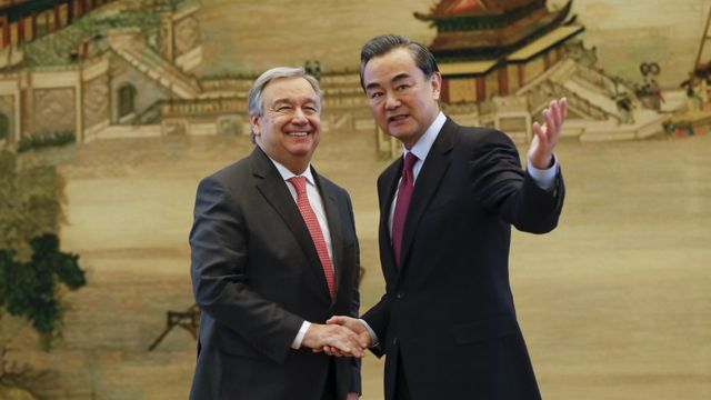 Chinese Foreign Minister Wang Yi (R) shakes hands with United Nations Secretary General-designate Antonio Guterres after a joint press conference at the foreign ministry on November 28, 2016 in Beijing, China