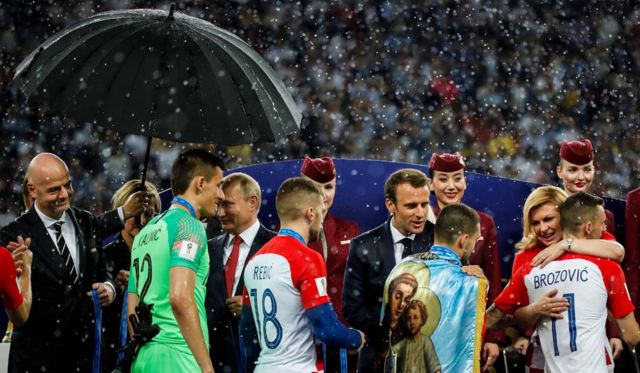 FIFA president Gianni Infantino, President of Russia Vladimir Putin, French President Emmanuel Macron and Croatian President Kolinda Grabar-Kitarović are seen following the 2018 FIFA World Cup Final between France and Croatia, 15 July 2018