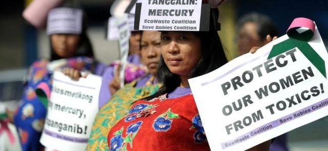 Filipino women dressed as pregnant mothers protest against imported Chinese cosmetics in Manila