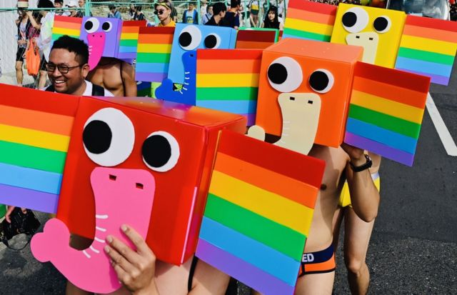Participants wear stylised rainbow elephant masks as they take part in the annual Pride parade in Taipei