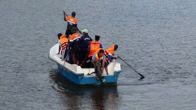Sri Lankan officials were pictured searching for Mr McClean's body in a lagoon near the village of Panama, Sri Lanka