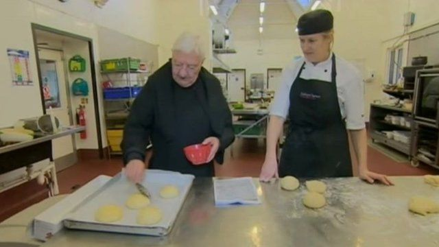 Monk making a Sally Lunn bun