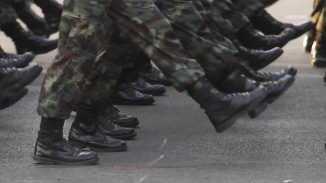 Close up of Thai soldiers' feet marching