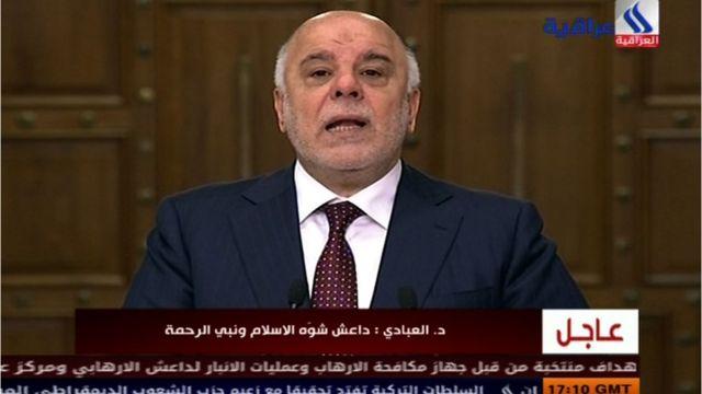 テレビ演説するイラクのアバディ首相(28日)