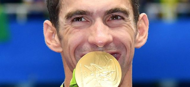 Michael Phelps with a gold medal at the Olympics Aquatics Stadium