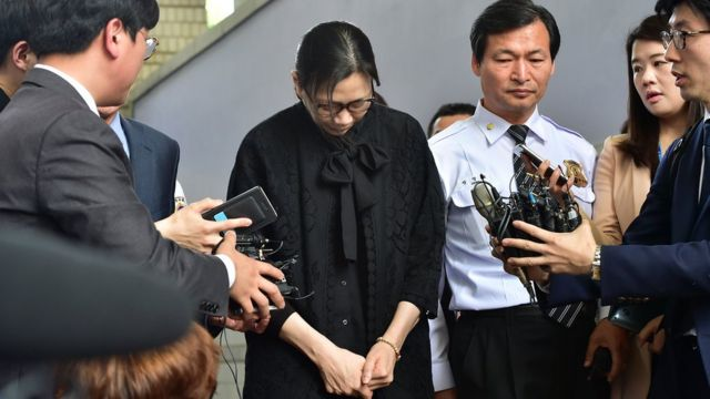 Heather Cho outside court in handcuffs