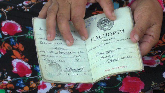Woman holds Soviet passport