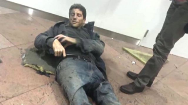 Sebastian Bellin lying injured at the airport in Brussels