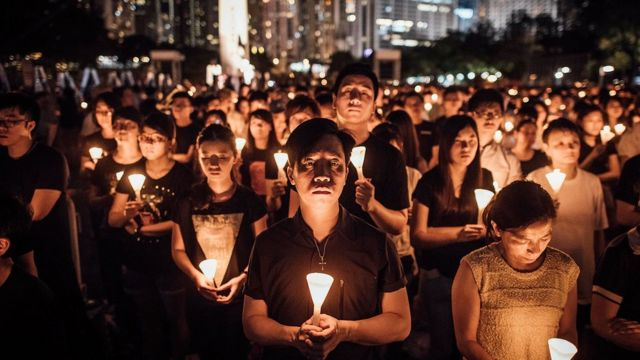 Participants take part at the candlelight vigil as they hold candles at Victoria Park on June 4, 2015 in Causeway Bay, Hong Kong.