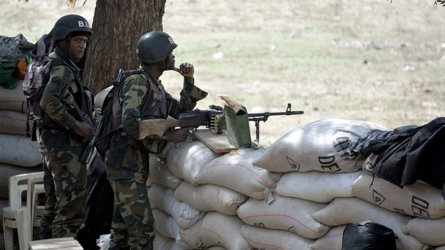 Cameroon soldiers for dey stand for dia station dey watch