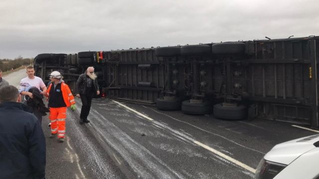 An overturned lorry on the M1