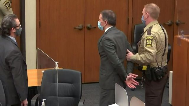 Former Minneapolis police officer Derek Chauvin is led away in handcuffs
