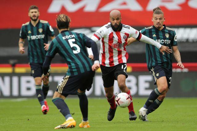 Kalvin Phillips and Robin Koch tackle Sheffield United's David McGoldrick