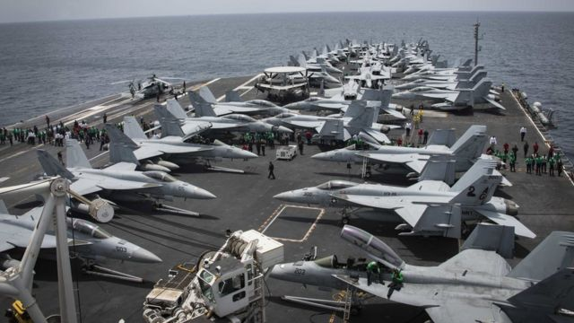 Handout photo from US Navy shows fighter jets on the deck of the USS Abraham Lincoln in the Arabian Sea on 19 May 2019