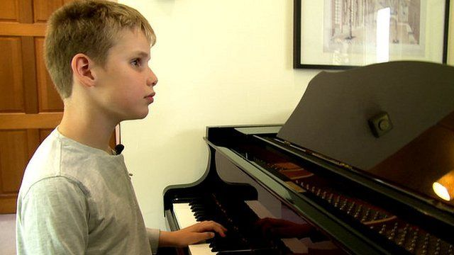 Ethan Loch playing the piano