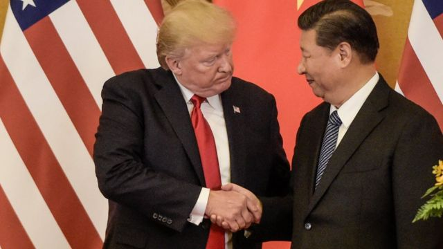 US President Donald Trump shakes hand with China's President Xi Jinping