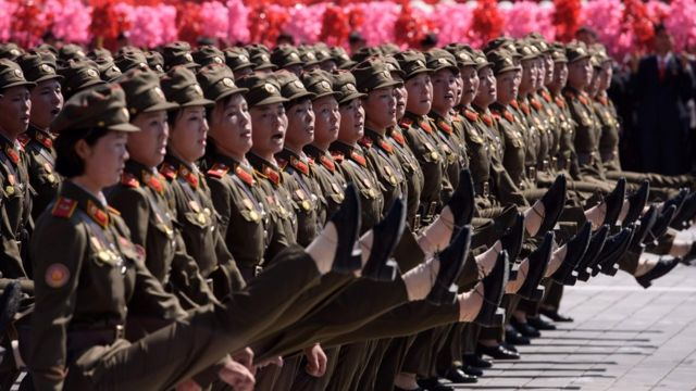 Korean People's Army (KPA) soldiers march during a mass rally