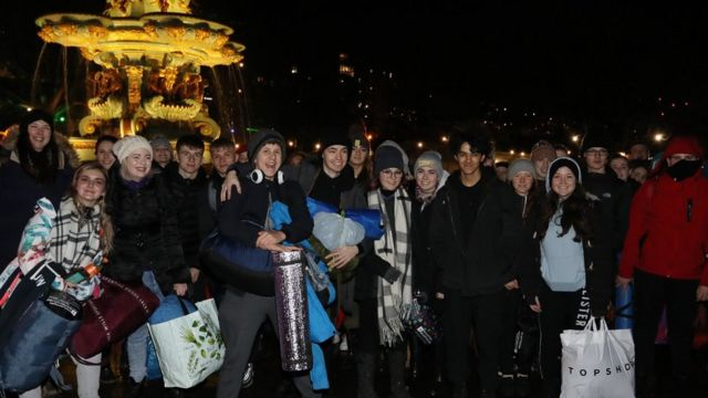 Young people gather before sleeping out in Trafalgar Square