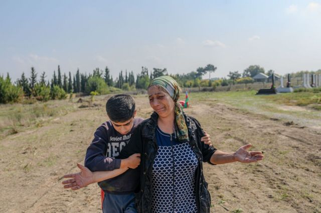 Aybeniz Khasanova beside the grave of her son