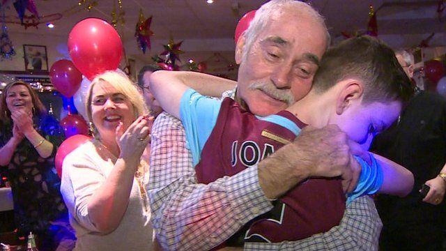 Jonjo Heuerman being hugged by his grandfather