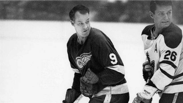 """Gordie Howe (L) is pictured in action against the Toronto Maple Leafs"""" Allan Stanley"""