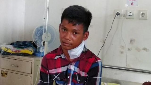 Muhammad Idul sitting in hospital
