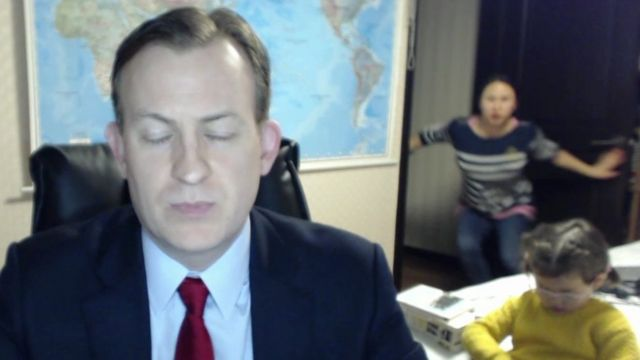 Screen grab from Prof Kelly's interview, with his wife and children in the background