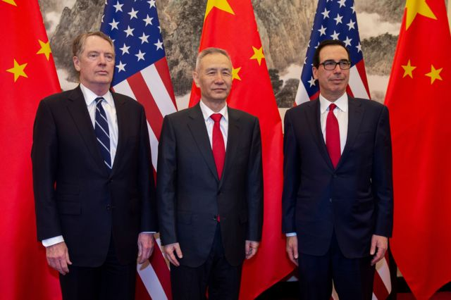 China's Vice Premier Liu He (C) poses for a photo with US Treasury Secretary Steven Mnuchin (R) and US Trade Representative Robert Lighthizer (L) at Diaoyutai State Guesthouse in Beijing on March 29, 2019