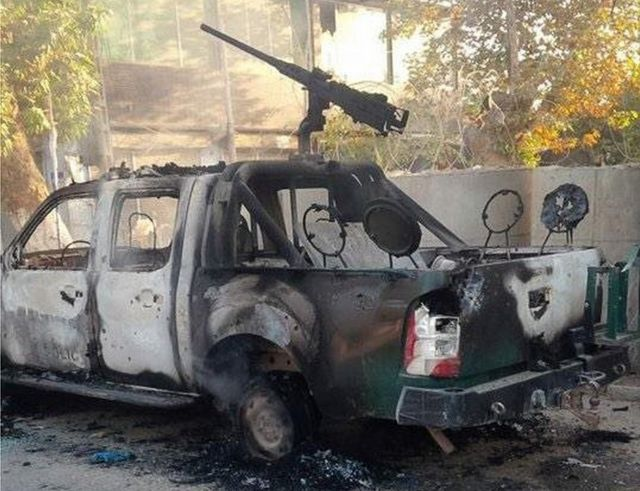 The burned-out shell of a security forces vehicle