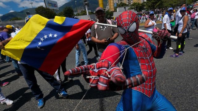 Supporters of Venezuelan opposition leader Juan Guaido take part in a rally in Caracas, on February 23, 2019