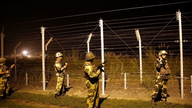 Indian Border Security Force (BSF) soldiers, patrol, fence at the India-Pakistan International Border