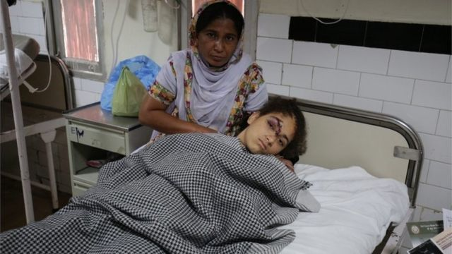 A relative of a victim of an automobile accident stands near her as she undergoes treatment at a hospital at Wallah village near Amritsar, India, 22 May 2016
